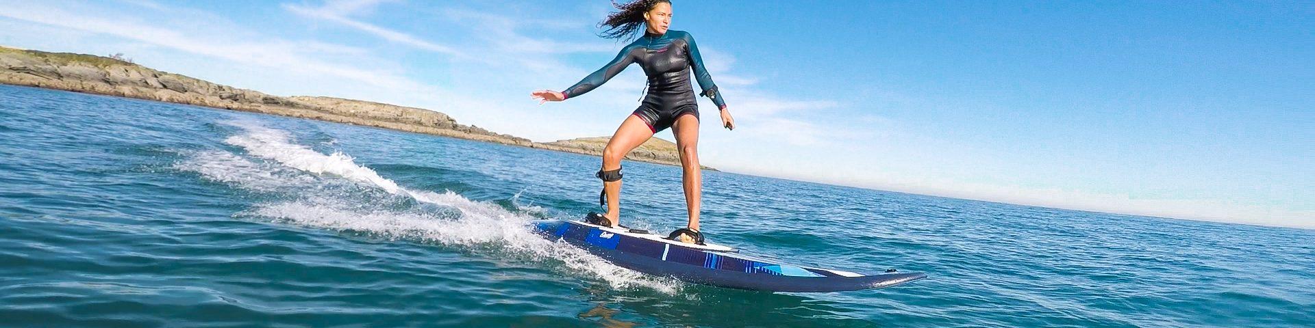 surf électrique Carver Twin Onean vue latérale action